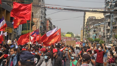Protesters march on a street in Yangon, Myanmar, Feb. 7, 2021. (Credit: VOA Burmese Service)