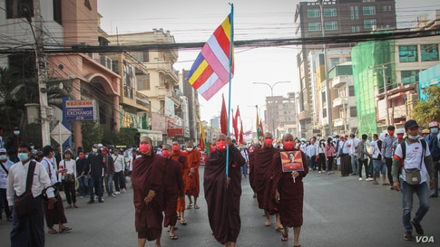 Buddhist monks march during a nationwide protest against the military coup in Mandalay, Myanmar, Feb. 22, 2021.