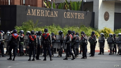 Riot police are deployed outside the American Center in Yangon, Myanmar, Feb. 22, 2021.