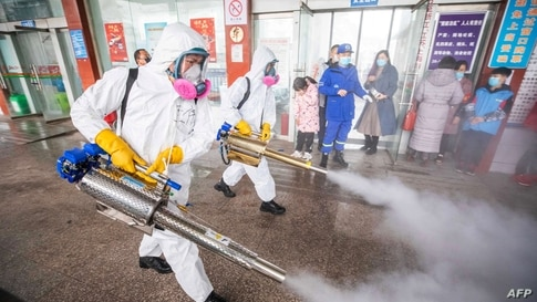 Workers disinfecting a bus station in Bijie, in China's southwest Guizhou province, as authorities prepare for a travel peak ahead of the Lunar New Year, which ushers in the Year of the Ox.
