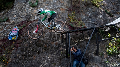 Colombian cyclist Camilo Sanchez is seen in action during the Red Bull Monserrate Cerro Abajo competition in Bogota, Feb. 6, 2021.