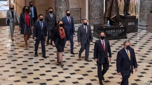 House impeachment managers walk to the Senate floor as they arrive for the start of the Senate trial of former President Donald Trump, on Capitol Hill, in Washington, Feb. 9, 2021.