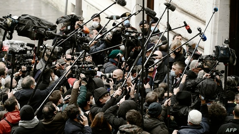 Journalists gather upon the arrival of leader of the right-wing party Forza Italia, Silvio Berlusconi (not in picture) at Palazzo Montecitorio, the seat of the lower house of parliament in Rome, Italy, for a meeting with ex-central banker Mario Draghi.