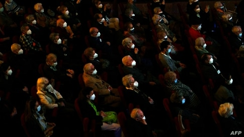 Residents of nursery homes for the elderly, who have already received a Covid-19 vaccine, attend a performance at the EDP Gran Via Theatre in Madrid, Spain.