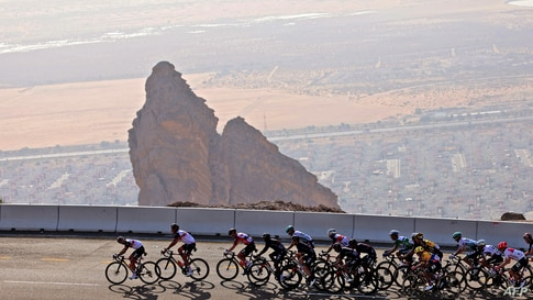 The pack rides during the third stage of the UAE Cycling Tour from Al Ain to Jebel Hafeet, United Arab Emirates.