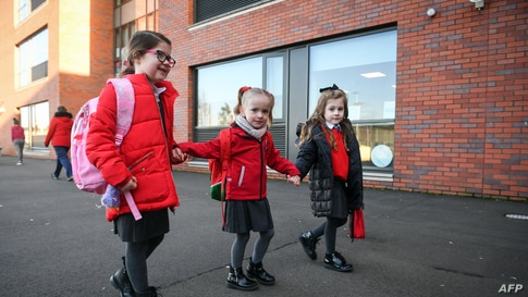 Pupils arrive at Clyde Primary School in Glasgow as schools in Scotland started to reopen to more of the youngest students in an easing of the coronavirus shutdown.