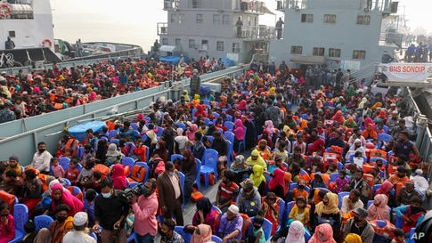 Rohingya refugees headed to the Bhasan Char island board navy vessels from the south eastern port city of Chattogram, Bangladesh.