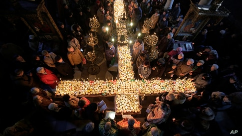 Worshippers gather around a cross during Mass for the 'sanctification of honey' at the Presentation of the Blessed Virgin church in the town of Blagoevgrad, some 100 km (62 miles) south of the Bulgarian capital of Sofia.