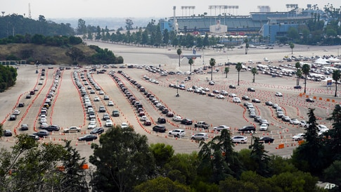 Motorists line up to receive a COVID-19 vaccine at a Los Angeles County location at Dodger Stadium in Los Angeles, California, Feb. 10, 2021.