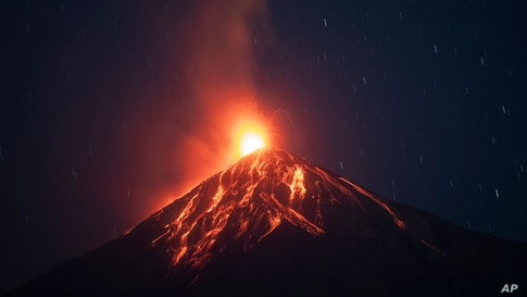 Lava flows down from the crater of the Volcan de Fuego, or Volcano of Fire, in Alotenango, Guatemala, Feb. 14, 2021.