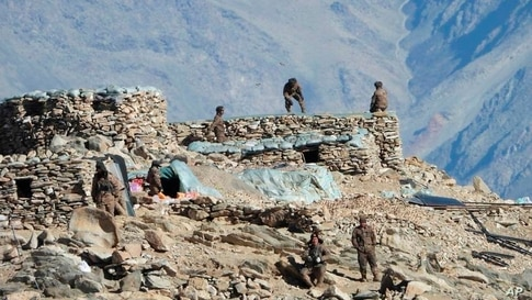 This photograph provided by the Indian Army, shows Chinese troops dismantling their bunkers at Pangong Tso region, in Ladakh along the India-China border, Feb.15, 2021.