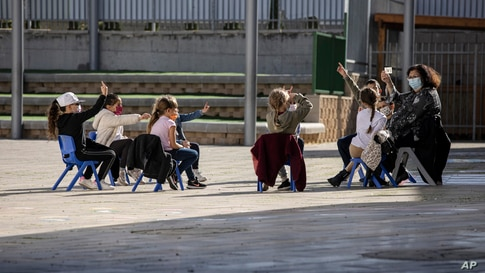 Israeli students attend class in the school yard in the costal city of Ashkelon.