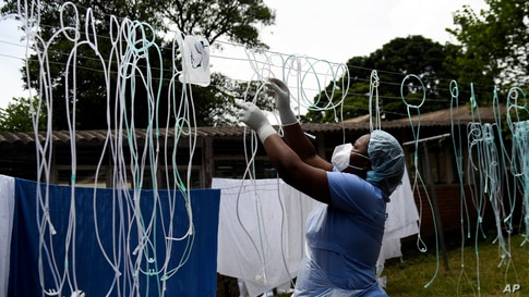 A health worker dries decontaminated nasal prongs and oxygen face masks at Queen Elizabeth Central Hospital in Blantyre, Malawi.