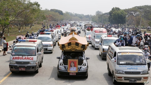 A hearse containing casket of Mya Thwet Thwet Khine travels to the cemetery in Naypyitaw, Myanmar.