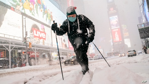 Steve Kent skis through Times Square during a snowstorm in the Manhattan borough of New York.
