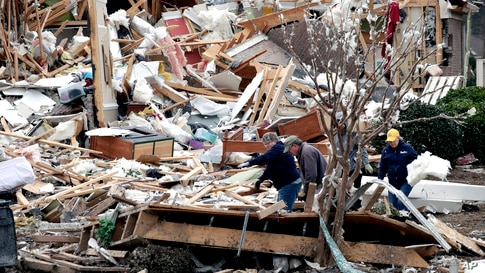 People sift through the rubble of homes at the Ocean Ridge Plantation in Brunswick County, North Carolina, Feb. 17, 2021, after a tornado hit the area Monday night.
