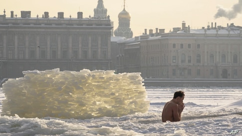 A man bathes in an ice hole in the Neva River St. Petersburg, Russia.