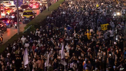 Hundreds of pro-democracy protesters march demanding the release of pro-democracy activists in Bangkok, Thailand.
