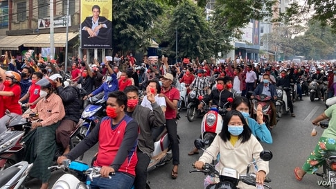 Motorcyclists hold a peaceful protest against the military coup in Mandalay, Myanmar, Feb. 6, 2021.