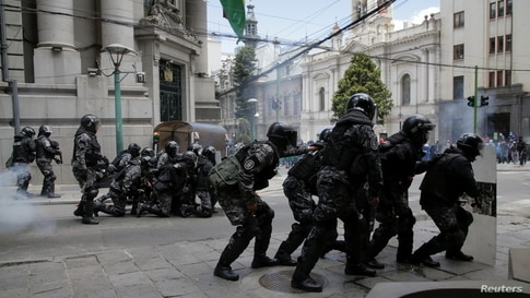Riot police take position during a protest of healthcare workers against new government measures amidst the coronavirus disease (COVID-19) outbreak, in La Paz, Bolivia.