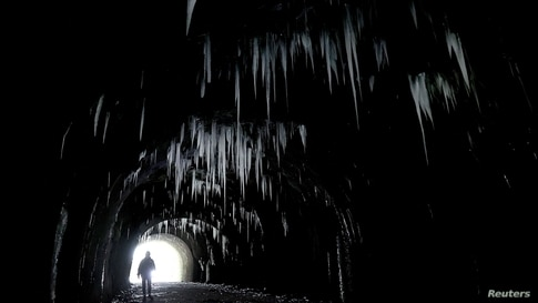 Icicles hang from the roof of Hopton Tunnel, near the village of Hopton, Derbyshire, Britain.