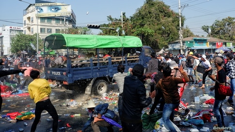 Demonstrators clash with riot police during a protest against the military coup in Mandalay, Myanmar, Feb. 9, 2021.
