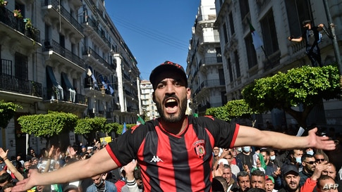 An Algerian anti-government demonstrator shouts slogans during a protest in the capital Algiers, on March 12, 2021. (Photo by…