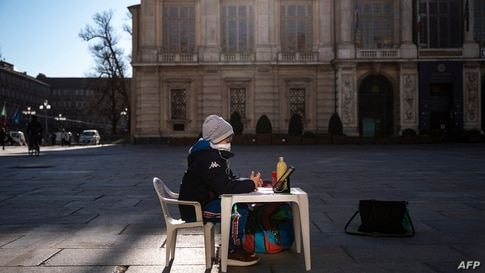 A pupil sits on Piazza Castello on March 17, 2021 in Turin during a sit-in protest against the closure of schools…