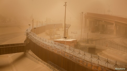 A general view shows a section of the border wall in El Paso, Texas, U.S., during a sandstorm, as seen from Ciudad Juarez,…
