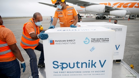 FILE PHOTO: Workers take care of the shipment of Russia's Sputnik V vaccine against the coronavirus disease (COVID-19) at the…