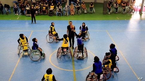 Disabled Afghan women participate in a wheelchair basketball match between Kabul and Balkh provinces in Kabul, Afghanistan,…
