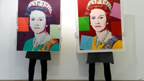 Gallery technicians display Andy Warhol screenprints Queen Elizabeth II, from: Reigning Queens screenprint in colours, 1985,…