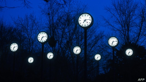 Clocks of the art installation 'Zeitfeld' (time field) by German artist Klaus Rinke are seen in Duesseldorf, western Germany.