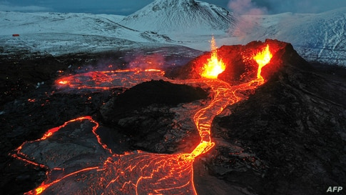 Lava flows from an eruption of a volcano on the Reykjanes Peninsula in Iceland, March 28, 2021.