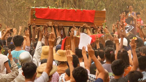 This photo received via Facebook shows mourners making the three-finger salute during funerals of three protesters, who were shot dead the day before during a crackdown by security forces on anti-coup demonstrations in Monywa, Sagaing region, Myanmar.