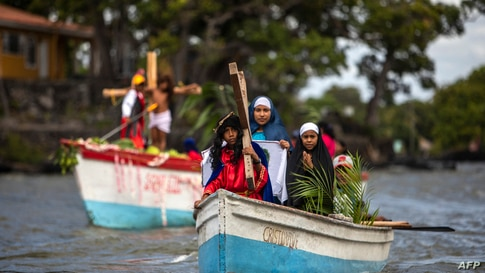 Catholic faithful take part in the aquatic re-enactment of the Way of the Cross on Lake Cocibolca, or Lake Nicaragua, in Granada, some 48 km southeast of Managua, Nicaragua, March 29, 2021, amid Holy Week celebrations.