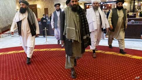 Taliban political deputy Mullah Abdul Ghani Baradar, center, arrives with other members of the Taliban delegation for an international peace conference in Moscow, Russia, March 18, 2021.