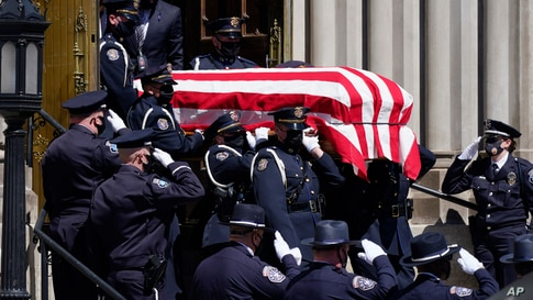 The casket carrying the body of fallen Boulder Police Department officer Eric Talley is carried by a Denver Police honor guard to a waiting hearse after a service at the Cathedral Basilica of the Immaculate Conception, March 29, 2021, in Denver, Colorado.