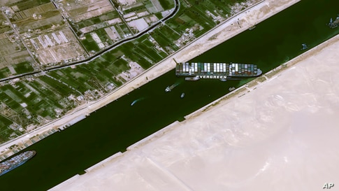 This satellite image from Cnes2021, Distribution Airbus DS, shows the cargo ship MV Ever Given stuck in the Suez Canal near Suez, Egypt.