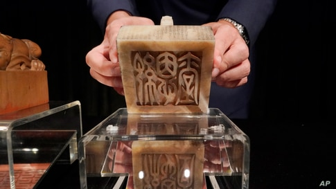 """The Imperial Inscribed White Jade """"Ji'entang"""" Seal for the Qianlong Period of China's Qing Dynasty is displayed during the Sotheby's auction preview in Hong Kong.The seal is expected to fetch $16.1 - 23.2 million."""