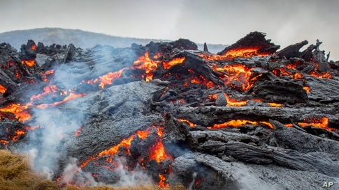 Lava flows from an eruption of a volcano on the Reykjanes Peninsula in southwestern Iceland, March 20, 2021.