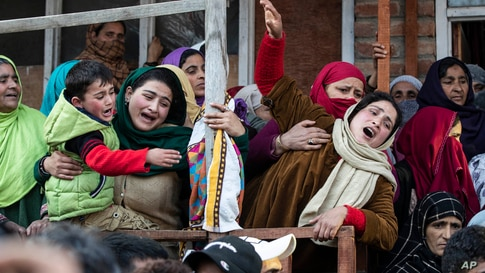 Relatives and family members cry near the coffin of elected official Riyaz Ahmad in Sopore, 55 kilometers (34 miles) north of Srinagar, Indian-controlled Kashmir.