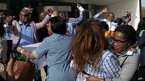 Supporters of former Ivory Coast President Laurent Gbagbo and former youth minister Charles Ble Goude, celebrate their acquittal outside the International Criminal Court in The Hague, Netherlands.