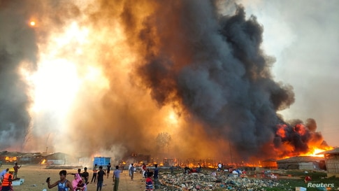 Smoke billows at the site of the Rohingya refugee camp where fire broke out in Cox's Bazar, Bangladesh, March 22, 2021.