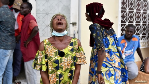 Women cry after Congo Republic's opposition presidential candidate Guy Brice Parfait Kolelas died from COVID-19 at the Union of Humanist Democrats offices in Brazzaville.