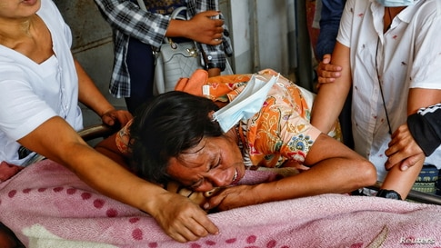 Family members cry over the dead body of a teenage boy Tun Tun Aung who was shot dead by security forces in front of his home in Mandalay, Myanmar.