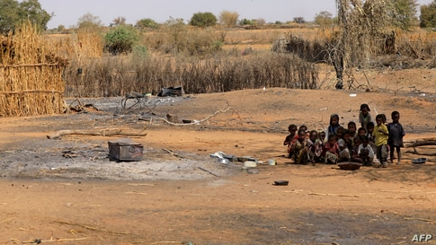 Sudanese children sit together following violence in the village of al-Twail Saadoun, 85 kilometres south of Nyala town, the…