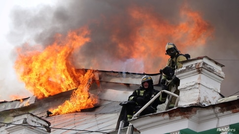 Firefighters work to extinguish a fire at a local clinic of cardiac surgery in the city of Blagoveshchensk, Russia April 2,…