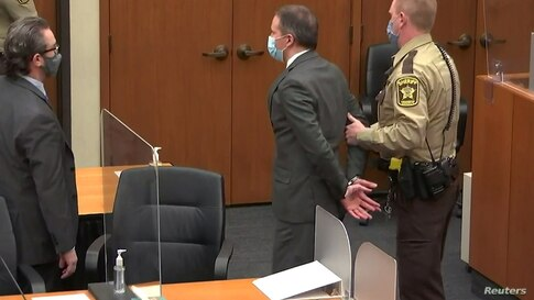 Former Minneapolis police officer Derek Chauvin is led away in handcuffs after a jury found him guilty of all charges in his trial for murder in the death of George Floyd in Minneapolis, Minnesota, April 20, 2021.