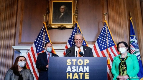 Senate Majority Leader Chuck Schumer (D-NY) is joined by fellow Democrats as he speaks at a news conference.